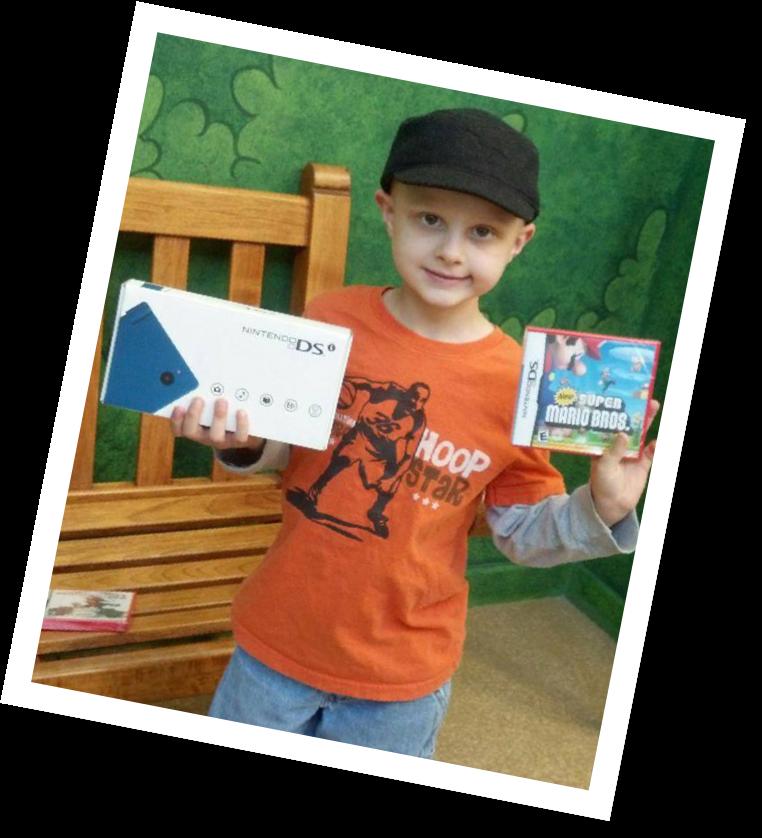 Boy holding Nintendo games